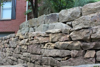 natural stone retaining wall project -stacked
